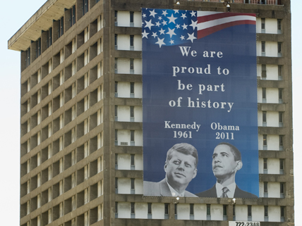 building with banner of Obama and Kennedy