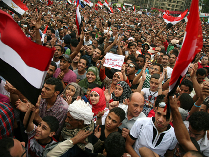 Egyptian protesters with flags