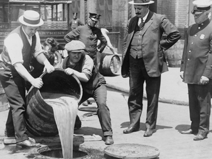 NYC Prohibition authorities pouring alcohol into sewer