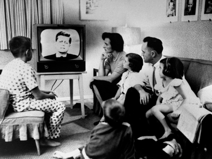 family around TV set in 1960