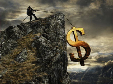 image of golden dollar-bill symbol held by rope dangling off cliff