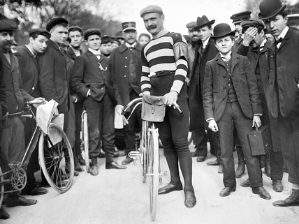 pro cyclist with bike and crowd, 1905