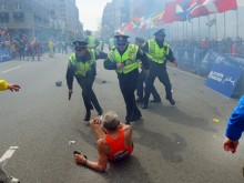 fallen runner and police near finish line of 2013 Boston Marathon
