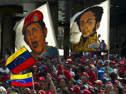 political rally in Venezuela with Chavez and Bolivar banners