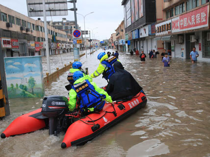 Firefighters help citizens with their vehicles and safety as Typhoon In-fa brought heavy rainstorm and caused flood water in Ningbo city, east China's Zhejiang province, 26 July 2021.